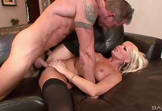 Wretched blonde deals the dick on a leather settee